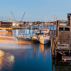 A boat leaves the commercial fish pier in Portsmouth, New Hampshire.