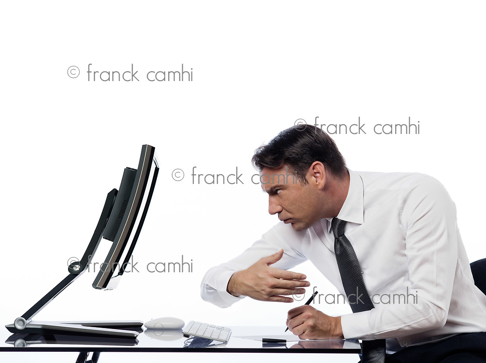 relationship between a caucasian man and a computer display monitor on isolated white background expressing spy concept
