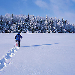 Snowshoeing across Second Connecticut Lake.  Northern Forest.  Winter sports.  Pittsburg, NH