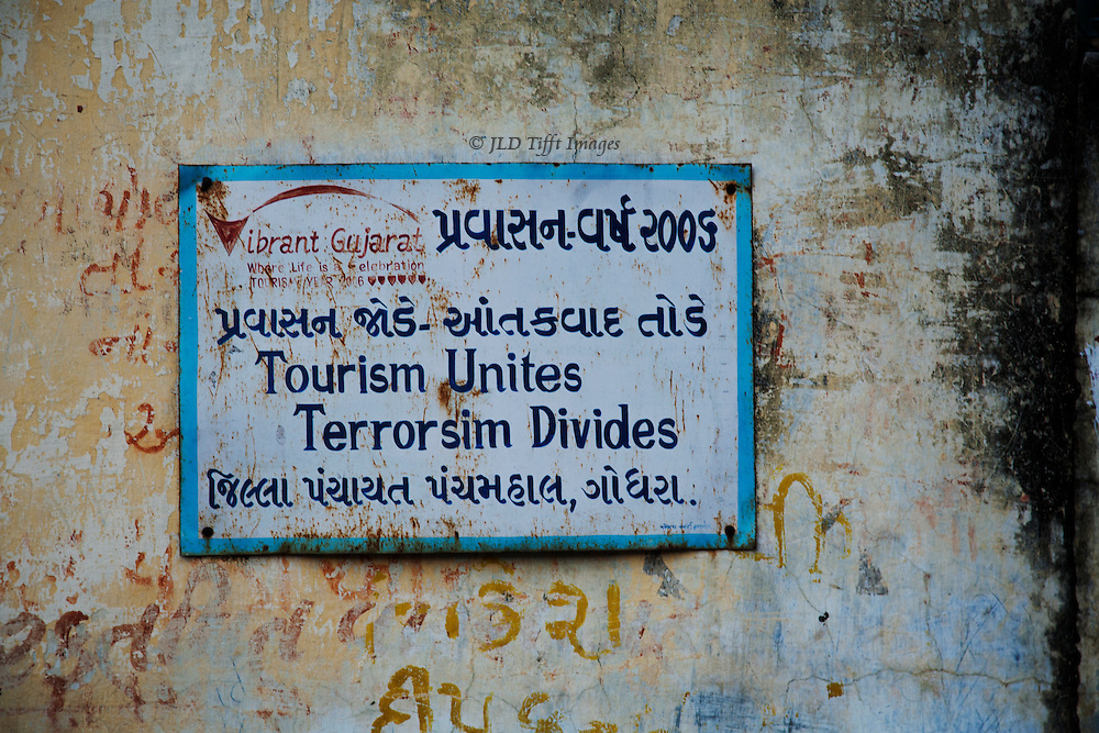 """Sign in Gujarat, India: """"Tourism unites Terrorsim divides."""""""