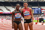 Jenna Prandini of the United States of America celebrates her win in the Women's 200m final with Dina Asher-Smith of Great Britain during the Muller Anniversary Games, Day Two, at the London Stadium, London, England on 22 July 2018. Picture by Martin Cole.