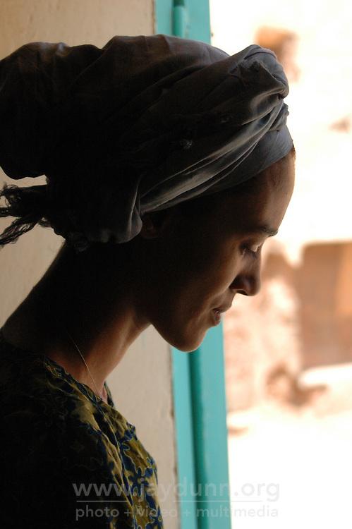 Niger,Agadez,2007. Halimata Ixa-Graille in the doorway of Fatima Ixa's traditional handicrafts shop in the center of Agadez.