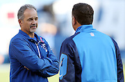 (L-R) Indianapolis Colts head coach Chuck Pagano talks to brother and San Diego Chargers defensive coordinator John Pagano before the NFL week 6 football game against the Indianapolis Colts on Monday, Oct. 14, 2013 in San Diego. The Chargers won the game 19-9. ©Paul Anthony Spinelli