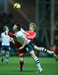 PRESTON, ENGLAND - Saturday, January 3, 2009: Liverpool's Fernando Torres and Preston North End's Sean St. Ledger during the FA Cup 3rd Round match at Deepdale. (Photo by David Rawcliffe/Propaganda)