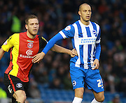 Brighton striker Bobby Zamora  tries to shrug off the attentions of Birmingham City defender Michael Morrison  during the Sky Bet Championship match between Brighton and Hove Albion and Birmingham City at the American Express Community Stadium, Brighton and Hove, England on 28 November 2015. Photo by Bennett Dean.