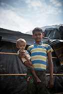 Along with four other siblings and both parents -- and several hundred thousand other Rohingya Muslims --13-year-old Mohammed Asfar and his one-and-a-half-year-old brother Mohammed Saat recently fled Myanmar. They know live in a shelter at Batukhali refugee camp in Bangladesh. Many children arrive with severe acute malnutrition. (October 28, 2017)
