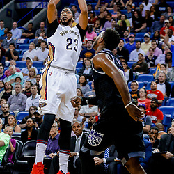 Mar 31, 2017; New Orleans, LA, USA; New Orleans Pelicans forward Anthony Davis (23) shoots over Sacramento Kings guard Buddy Hield (24) during the first quarter of a game at the Smoothie King Center. Mandatory Credit: Derick E. Hingle-USA TODAY Sports