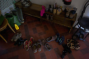 Volunteers' boots and shoes at the Rivendell Buddhist Retreat Centre, East Sussex, England.