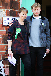 © Licensed to London News Pictures. 07/05/2015. Brighton, UK. The Green Party MP Caroline Lucas arrives with her son Isaac at Florence Rd Baptist Church Hall in Brighton to vote in the General Election, today May 7th 2015. Photo credit : Hugo Michiels/LNP