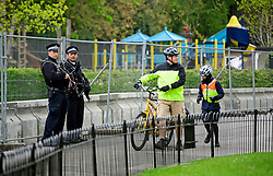 © London News Pictures. 22/04/2016. London, UK. Armed police stand next to a child's play area in regents park where heightened security surrounds the residence of the US Ambassador to the United Kingdom in Regents Park, London, where the President of the United States Barak Obama is staying during his visit to the UK. Photo credit: Ben Cawthra/LNP