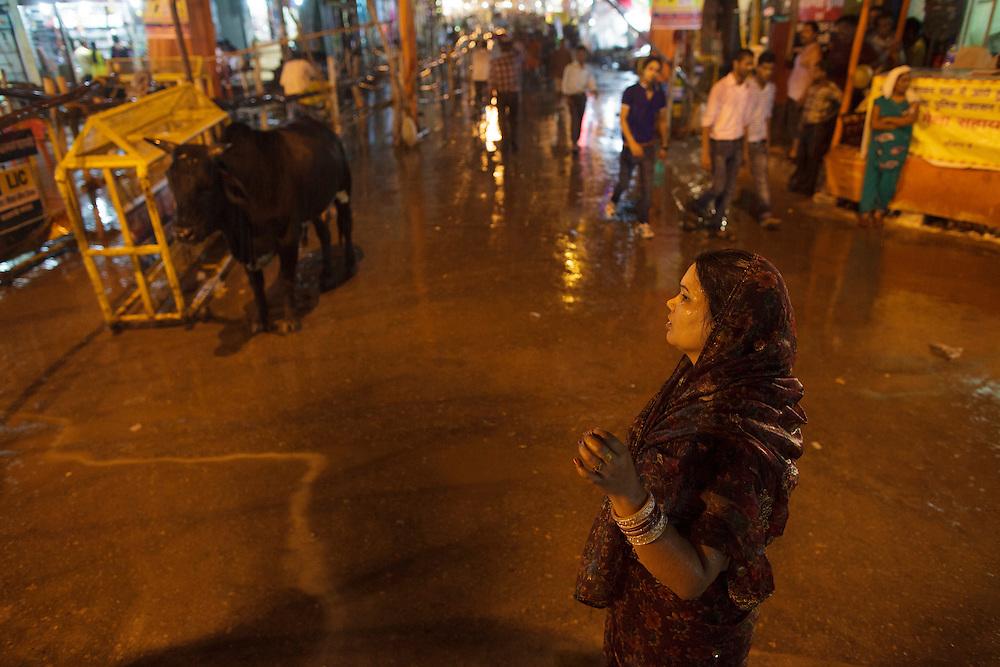 Woman on the rain at a crossing in Varanasi, India.