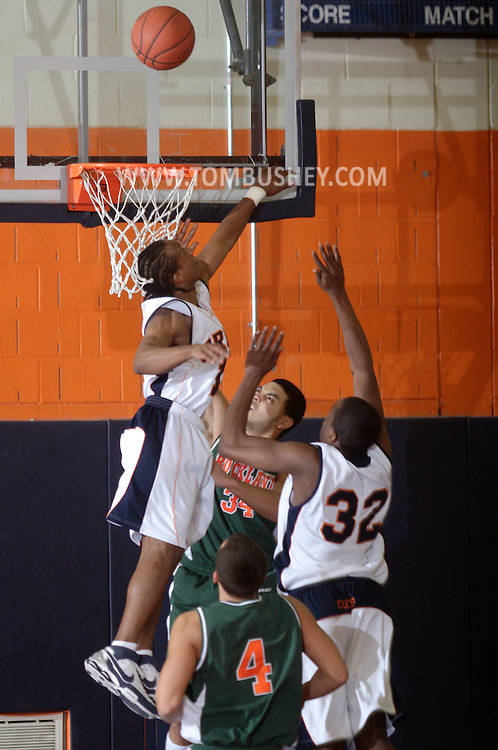 Middletown, NY - Stefan Bonneau (12) of SUNY Orange tries to block a shot against Rockland Community College in a Mid-Hudson Conference game in Middletown on Feb. 26, 2008.
