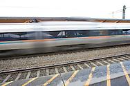 The Airport Express Train passing Lillestrøm Station, bound for Oslo..Flytoget passerer Lillestrøm stasjon, på vei mot Oslo