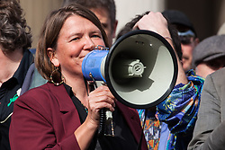 London, UK. 16 October, 2019. Ellie Chowns, Green Party MEP, addresses hundreds of climate activists from Extinction Rebellion defying the Metropolitan Police prohibition on Extinction Rebellion Autumn Uprising protests throughout London under Section 14 of the Public Order Act 1986 by attending a Right to Protest assembly in Trafalgar Square.