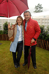 ARNAUD BAMBERGER MD of Cartier and his wife CARLA at the Cartier Style Et Luxe at the Goodwood Festival of Speed, Goodwood House, West Sussex on 24th June 2007.<br />