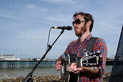 © licensed to London News Pictures. BRIGHTON, UK  13/05/11. JAMES VINCENT McMORROW plays an outdoor gig on Brighton Seafront in the sun with the peir in the background, Brighton on Friday 13th May 2011 as part of The Great Escape Festival. Persons pictured: JAMES VINCENT McMORROW. Please see special instructions for usage rates. Photo credit should read JULIE EDWARDS/LNP