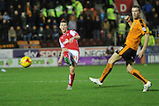 Rotherham United midfielder Richard Smallwood kicks forward  during the Sky Bet Championship match between Rotherham United and Wolverhampton Wanderers at the New York Stadium, Rotherham, England on 5 December 2015. Photo by Ian Lyall.