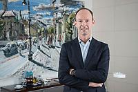 """27 MAR 2018, BERLIN/GERMANY:<br /> Thomas Rabe, Vorstandsvorsitzender Bertelsmann SE & Co. KGaA, in seinem Buero, vor einem Bild seines Freundes Christopher Lehmpfuhl (Rabe sagt, es kann verwendet werden) aus seiner Serie """"Berlin"""", Bertelsmann Repraesentanz Berlin ,Unter den Linden<br /> IMAGE: 20180327-01-001<br /> KEYWORDS: Büro"""