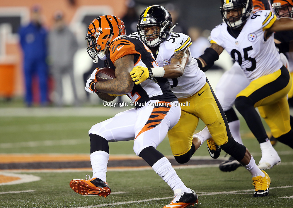 Pittsburgh Steelers inside linebacker Ryan Shazier (50) tackles Cincinnati Bengals running back Jeremy Hill (32) on the first play in the first quarter during the NFL AFC Wild Card playoff football game against the Cincinnati Bengals on Saturday, Jan. 9, 2016 in Cincinnati. The Steelers won the game 18-16. (©Paul Anthony Spinelli)