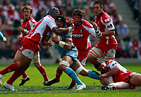 Photo: Richard Lane/Richard Lane Photography. Gloucester Rugby v Cardiff Blues. Anglo Welsh EDF Energy Cup Final. 18/04/2009. Blues' Ma'ama Molitika is tackled by Gloucester's akapusi Qera and Alex Brown.