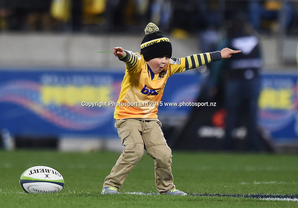 Young Hurricanes fan takes the match ball onto the field and does a dance during the Super Rugby Final between the Hurricanes and Highlanders at Westpac Stadium in Wellington., New Zealand. Saturday 4 July 2015. Copyright Photo: Andrew Cornaga / www.Photosport.nz