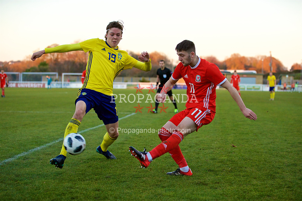 BANGOR, WALES - Saturday, November 17, 2018: Wales' Joseph Adams (R) and Sweden's Emil Holm during the UEFA Under-19 Championship 2019 Qualifying Group 4 match between Sweden and Wales at the Nantporth Stadium. (Pic by Paul Greenwood/Propaganda)