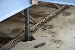 Signs of vandalism are show at the construction site of the Quaker Meeting House in Chestnut Hill.  ..A support column in the basement shows marks from a blowtorch.