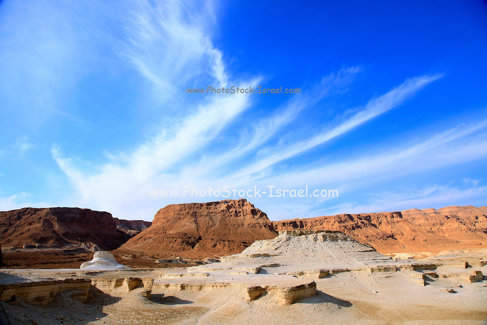 Eroded cliffs made of marl. Marl is a calcium carbonate-rich, mudstone formed from sedimentary deposits. Photographed in Israel, Dead Sea region