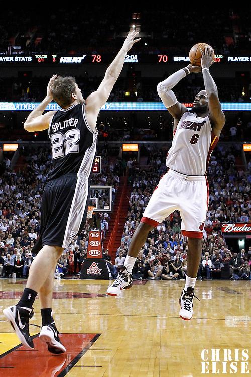 17 January 2012: Miami Heat small forward LeBron James (6) takes a jumpshot over San Antonio Spurs forward Tiago Splitter (22) during the Miami Heat 120-98 victory over the San Antonio Spurs at the AmericanAirlines Arena, Miami, Florida, USA.