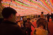 The annual Lotus Lantern Festival is held to celebrate Buddha's Birthday. Lanterns at Jogyesa temple. Participants taking souvenir snapshots.