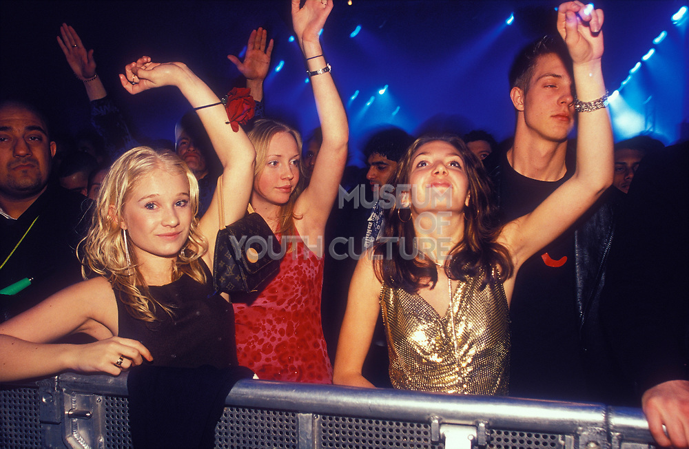 Ravers with their arms raised, Ministry of Sound, Millenium Dome, New Years Eve, London, U.K, 2000.
