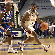 Kansas State's David Hoskins (15) drives around Jayhawk Russell Robinson (3), during the second half at Bramlage Coliseum in Manhattan, Kansas, March 4, 2006.  The Jayhawks won 66-52.