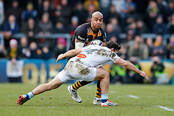 Wasps Winger Tom Varndell is tackled by Castres Olympique Winger Max Evans - Photo mandatory by-line: Rogan Thomson/JMP - 07966 386802 - 14/12/2014 - SPORT - RUGBY UNION - High Wycombe, England - Adams Park Stadium - Wasps v Castres Olympique - European Rugby Champions Cup Pool 2.