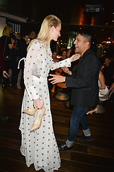 POPPY DELEVINGNE and OSMAN YOUSEFZADA at the Launch Of Osman Yousefzada's 'The Collective' 4th edition with special guest collaborator Poppy Delevingne held in the Rumpus Room at The Mondrian Hotel, 19 Upper Ground, London SE1 on 24th November 2014, sponsored by Storm models and Beluga vodka.