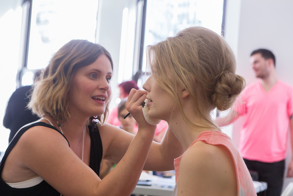 A model gets made up backstage at the Carmen Marc Valvo Spring 2013 Fashion Week show inNew York.