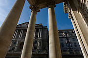 Bank of England  seen through rising pillars and columns of Cornhill Exchange, City of London.