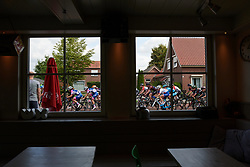 The peloton pass a frites shop at Boels Ladies Tour 2018 - Stage 3, a 129km road race in Gennep, Netherlands on August 30, 2018. Photo by Sean Robinson/velofocus.com