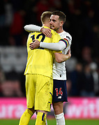 Jordan Henderson (14) of Liverpool gives Aaron Ramsdale (12) of AFC Bournemouth a hug at full time after Liverpools 3-0 win during the Premier League match between Bournemouth and Liverpool at the Vitality Stadium, Bournemouth, England on 7 December 2019.