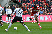 Antoine Semenyo (18) of Bristol City shoots at goal during the EFL Sky Bet Championship match between Bristol City and Derby County at Ashton Gate, Bristol, England on 27 April 2019.