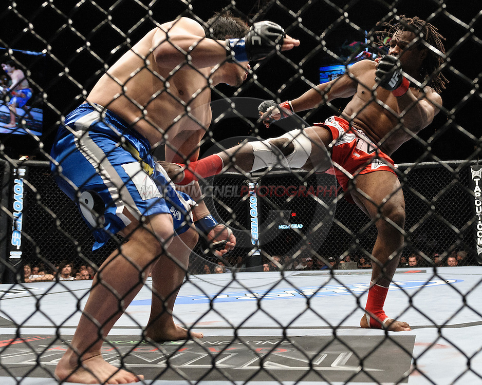 "LAS VEGAS, NEVADA, MAY 24, 2008: Kazuhiro Nakamura (left) attempts to catch a kick from Thierry Rameau Sokoudjou during ""UFC 84: Ill Will"" inside the MGM Grand Garden Arena in Las Vegas"