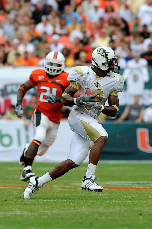 October 11, 2008 - Miami Gardens, FL<br /> <br /> University of Central Florida kick returner Joe Burnett returns a kick during the Knights 20-14 defeat to the Miami Hurricanes at Dolphin Stadium in Miami Gardens, Florida.<br /> <br /> JC Ridley/CSM