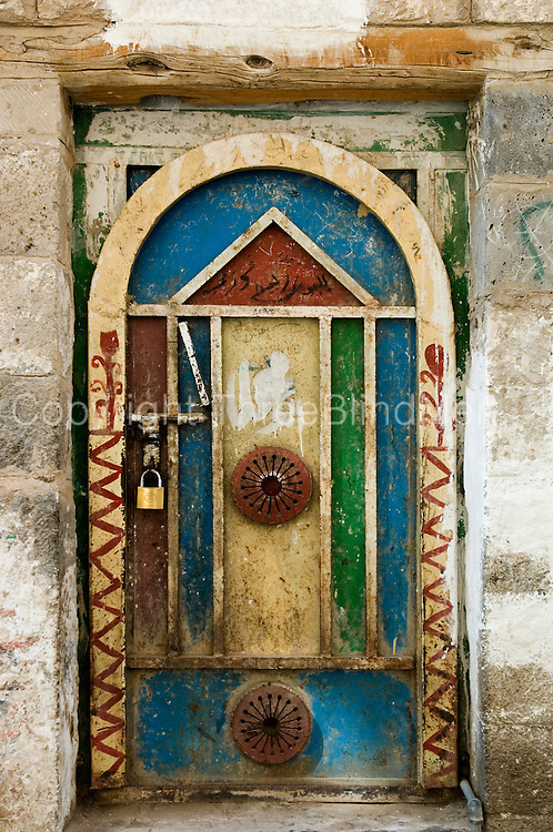 Metal doors tend to replace old wooden doors. This one is in the Old City of Sanaa.