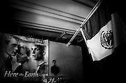 America, Latinoamerica, Mexico, Ensenada.  A old movie poster next to a mexican flag, in a worehouse -15.09.2006, FILM PHOTO, 48MB, copyright: Alex Espinosa/Gruppe28.