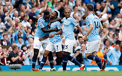 Manchester City's Raheem Sterling (second left) celebrates scoring his side's first goal of the game with team-mates during the Premier League match at the Etihad Stadium, Manchester.
