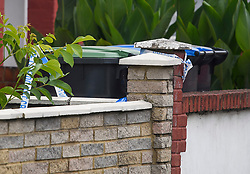 © Licensed to London News Pictures. 28/06/2018. London, UK. Police tape wrapped around a bin at the scene where a 20 year old man was stabbed to death yesterday evening in Edmonton, North London. Police were called to reports of a row between men armed with baseball bats on Wednesday evening. Photo credit: Ben Cawthra/LNP