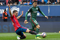 Unai Garcia of Club Atletico Osasuna competes for the ball with Aritz Aduriz of Athletic Club during the match of  La Liga between Club Atletico Osasuna and Athletic Club Bilbao at El Sadar Stadium  in Pamplona, Spain. April 01, 2017. (ALTERPHOTOS / Rodrigo Jimenez)