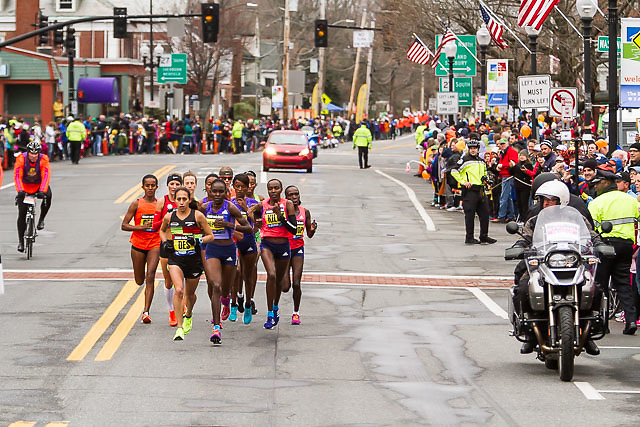 fans line race course as elite women runners pass by in Natick