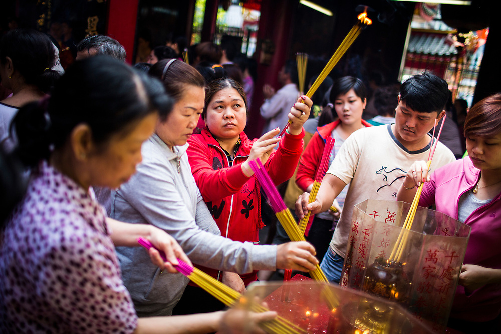 People light incense at Quan Am pagoda in District 5, Ho Chi Minh City, Vietnam.