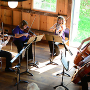 Jaroslaw Lis, Teri Einfeldt, Melinad Daetsch, Katie Kennedy, and Eric Dahli of The Arensky Ensemble performing in the barn at Moffatt-Ladd House in Portsmouth, NH. July 2012