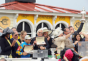 Trainer Bob Baffert, center, shows off another Longines timepiece after American Pharoah wins the 140th Preakness Stakes and the second leg of the Triple Crown, Saturday, May 16, 2015, in Baltimore, Md., with jockey Victor Espinoza.  Longines, the Swiss watch manufacturer known for its elegant timepieces, is the Official Watch and Timekeeper of the 140th annual Preakness Stakes and the Triple Crown. (Photo by Diane Bondareff/Invision for Longines/AP Images)